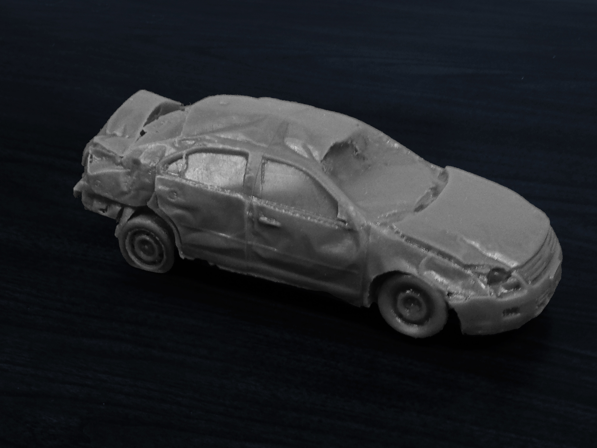 Subject Vehicle 3D Print Subject Vehicle Ford Fusion: This 3d print was used in court to show that, had it not been for the inertial release of the rear passenger's seatbelt the occupant would not have been ejected from the vehicle and would have likely have survived because the occupant compartment itself was left relatively unscathed.